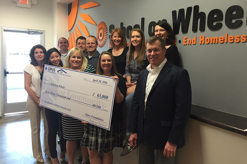 Opus associates surprised School on Wheels with a check for $63,000
