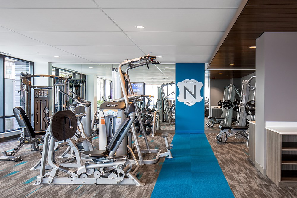 The Nic on Fifth features luxury amenities including a fitness and yoga studio.