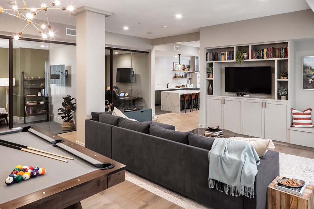 the clubroom, Luxer-enabled package room, work-from-home suites, pet spa and outdoor amenity deck at The Marke of Elmhurst