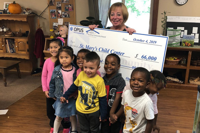 Children at St. Mary's Child Center smiling during the 2019 Opus Foundation's Building Community Award check presentation
