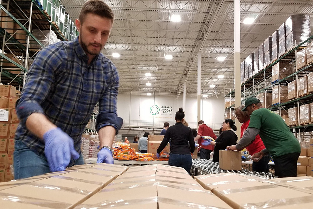 Greater Chicago Food Depository people working in food distribution center