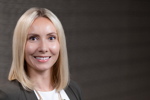 Headshot of Olga Olejniczak, real estate representative at Opus Development Company, L.L.C.