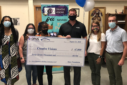 2020 Building Community Award winner Creative Visions check presentation
