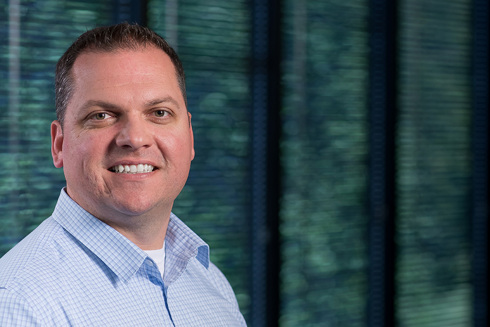 headshot of Todd Davis, senior manager of real estate development at Opus Development Company, L.L.C.