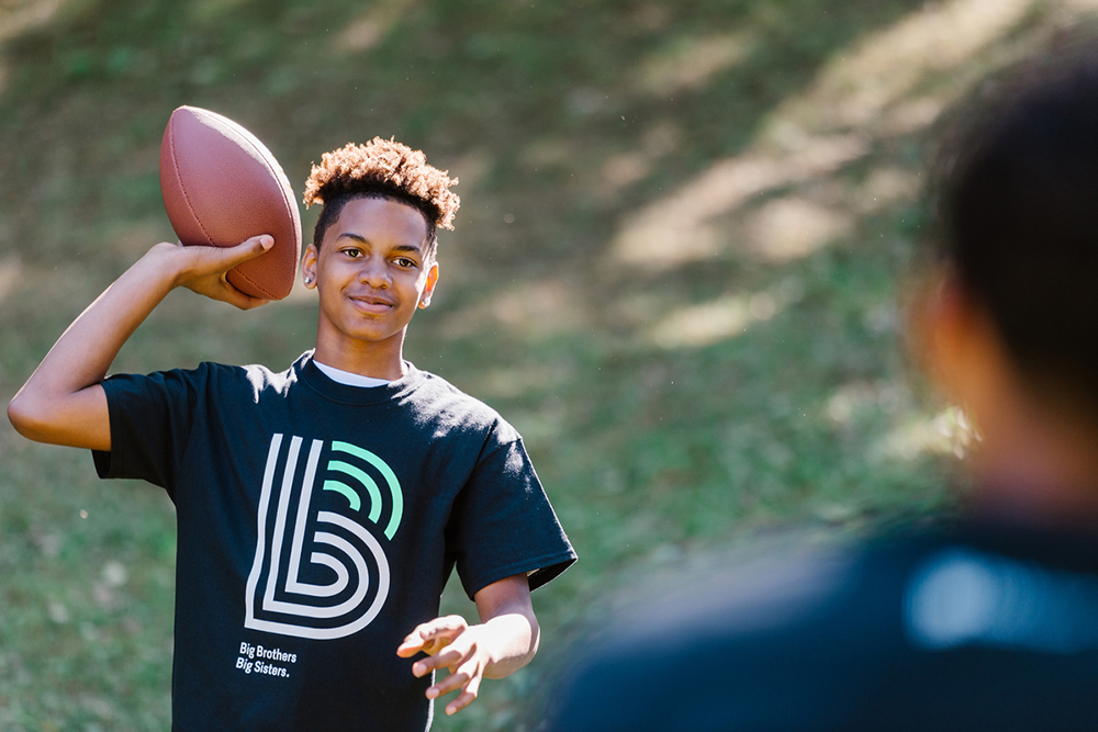 boy with footbal Brother Big Sisters Twin Cities