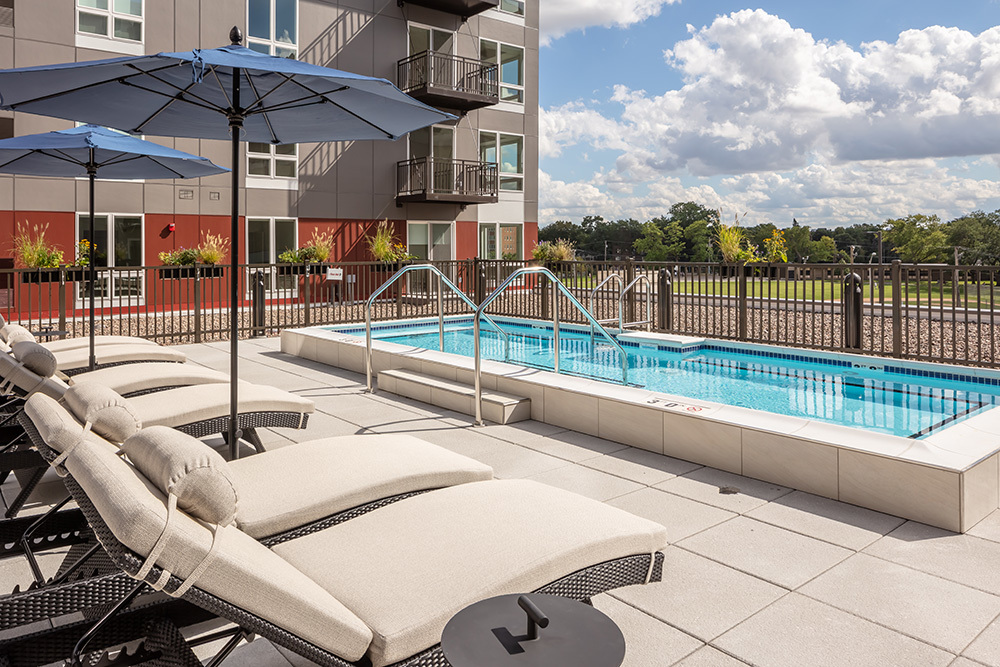 amenity outdoor patio lounge pool of Ellison Luxury Apartments in Illinois