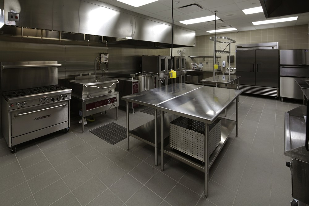 The catering kitchen at Iowa Army National Guard AFRC Complex includes top-of-the-line commercial appliances and prep spaces.
