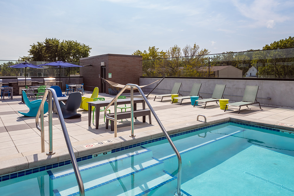 amenity lounge patio pool of The Union on Lincoln Way Student Living
