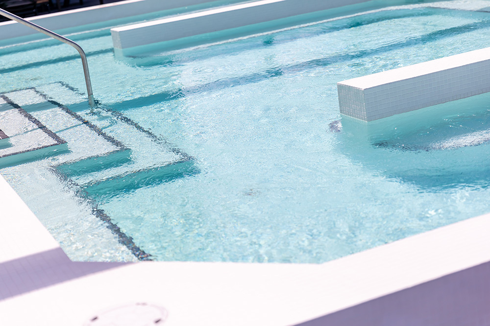 The Maven on Broadway Multifamily amenity outdoor swimming pool