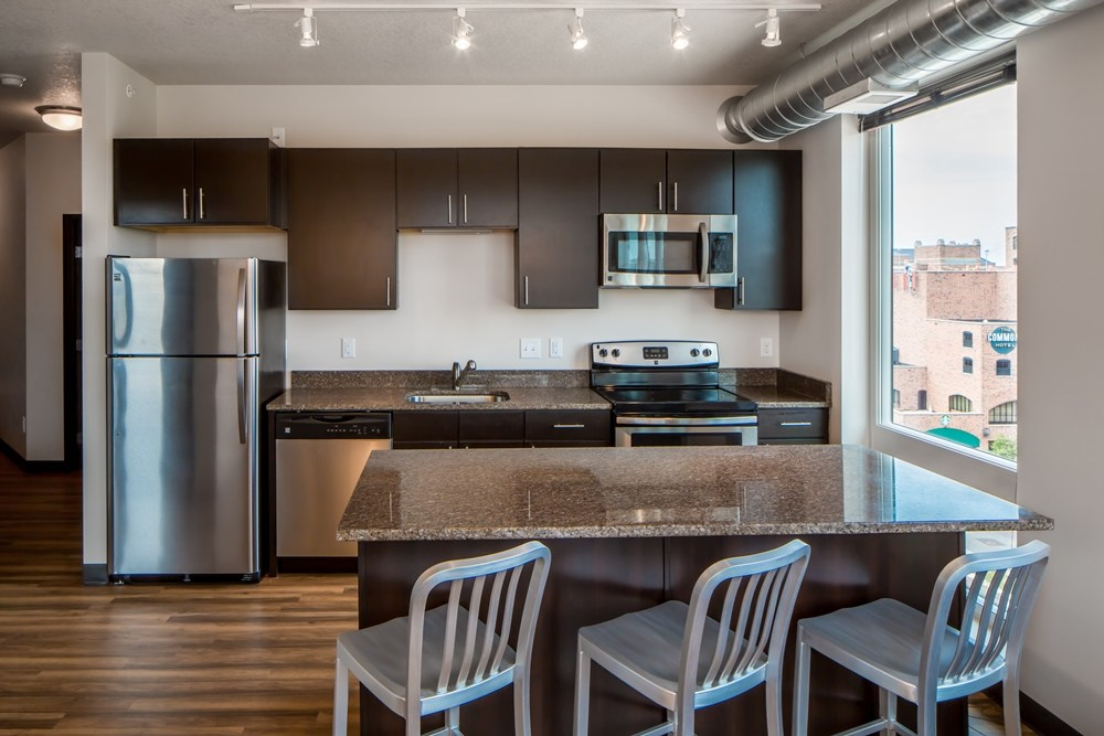 Unit kitchen at The Station on Washington Student Housing Development in Minneapolis