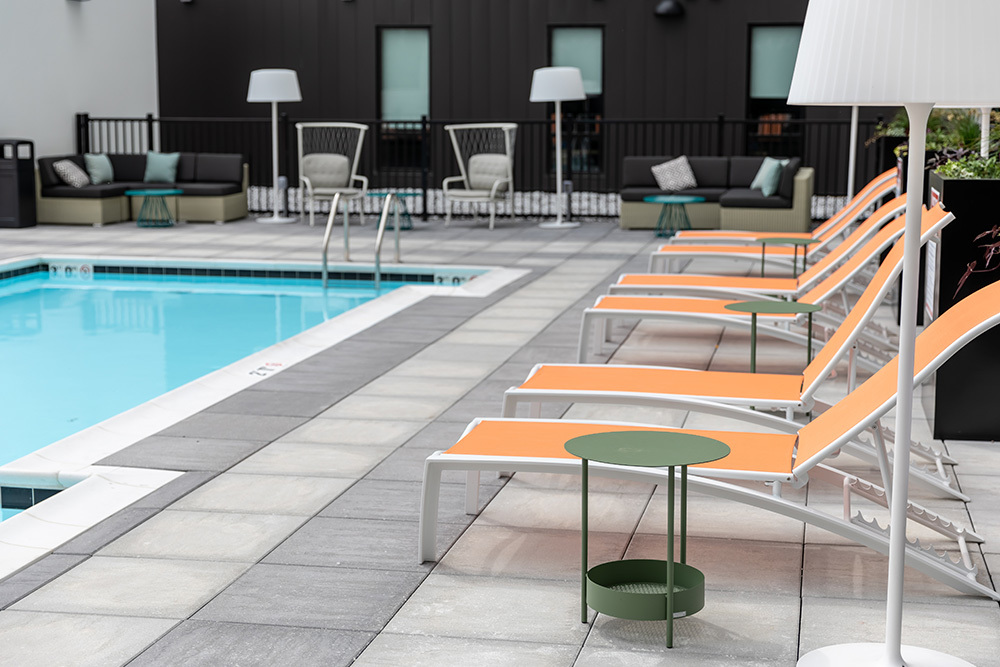 amenity outdoor patio pool deck of Seven07 U of I Student Living Development in Illinois