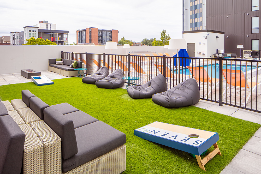 amenity outdoor patio seating game space of Seven07 U of I Student Living Development in Illinois