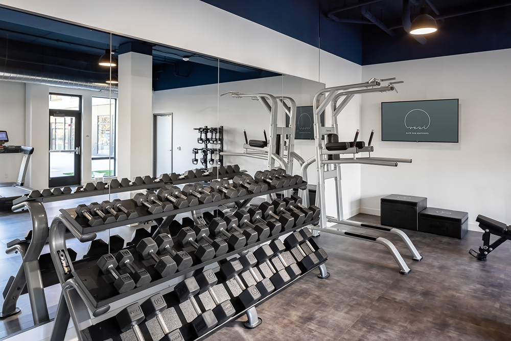 amenity free weights fitness center in Vesi apartment development